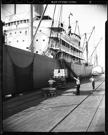 """Vodka unloaded from struck ship """"SS Steel Traveler"""" at Pier A, Bert 1, Long Beach Harbor, via court order, 1951"""