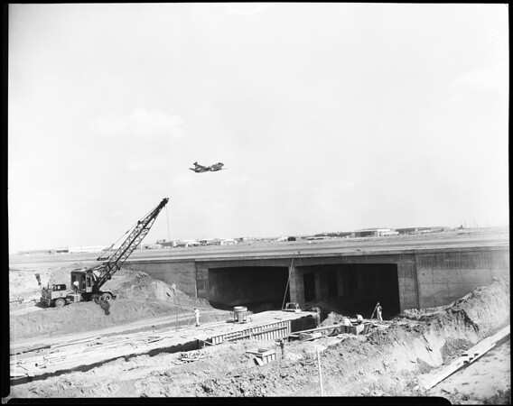 General views of completed portion, tunnel carrying Sepulveda Boulevard under extension of runways Los Angeles International Airport, 1952