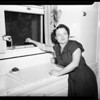 Woman who caught woman burglar, 1951