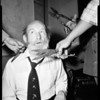 Vince Barnett gets a trimming (beard comes off), 1952