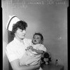 Rodriguez baby flown in from Tucson, Arizona, 1954