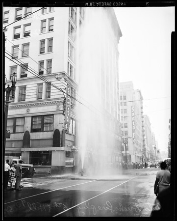 Fireplug sheared off, 6th and Hill, 1951