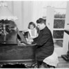 Pastor of San Gabriel Mission plays antique piano, 1952