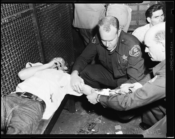 Suicide attempt (prisoner detention room off Department C., Long Beach), 1954