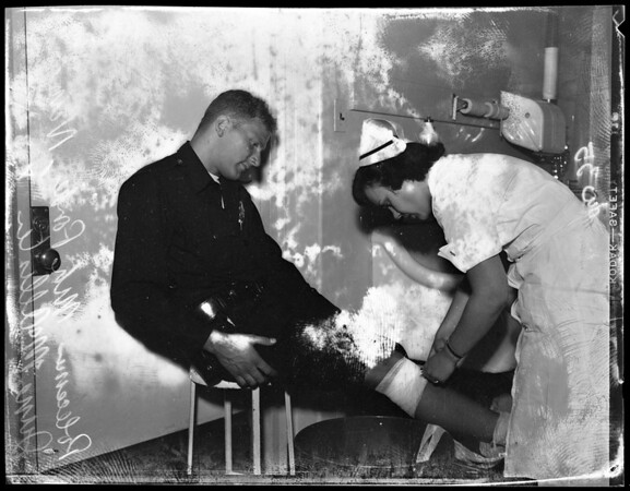 Policeman injured in fire at 2nd and Grand, 1954