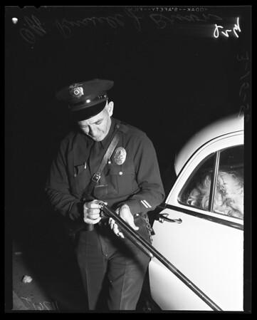 Woman and shotgun, 1956