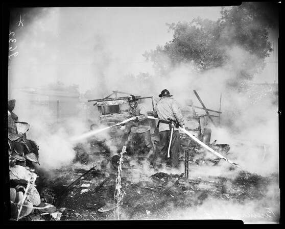 Illegal fire burns shed house (Valley), 1952