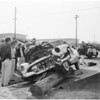 Narcotic shakedown plunged against power pole, 1954