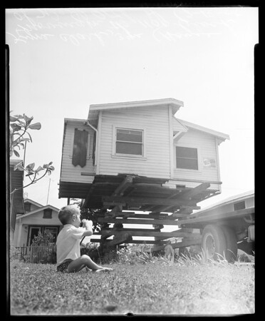 House moving in 1100 block of West 96th Street, 1955