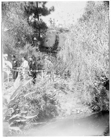 Hit and run car over embankment, 1952