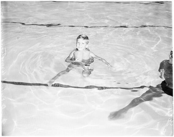 Swimming pool safety (kapok strap-down jacket), 1954