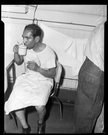 Loses clothes to burglar, 1954