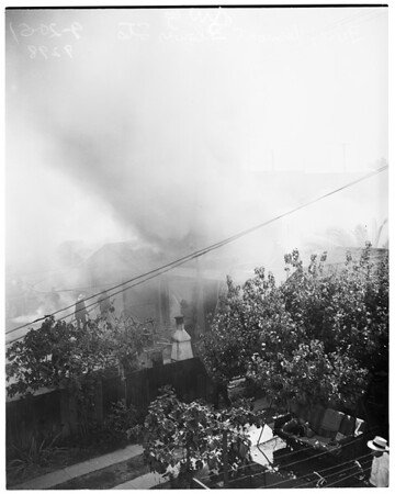 Garages and house burned, 1951