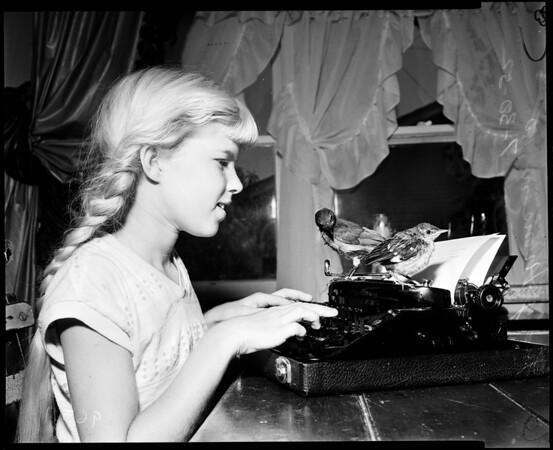 Girl raising birds, 1952