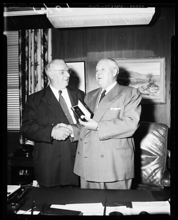 Veteran pressman retires and receives a watch, 1956