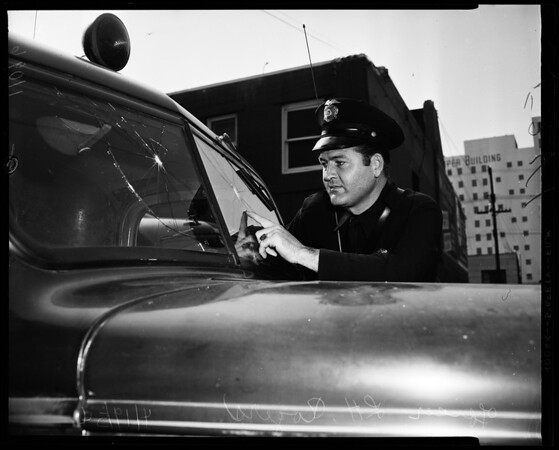 Police wind shield broken mysteriously, 1954