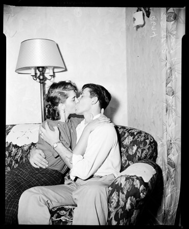 Swim-home Coast Guardsman returns home on liberty, 1952