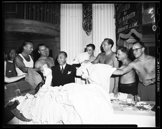 Advertising Club gives shirts off backs for Korea cause, 1951