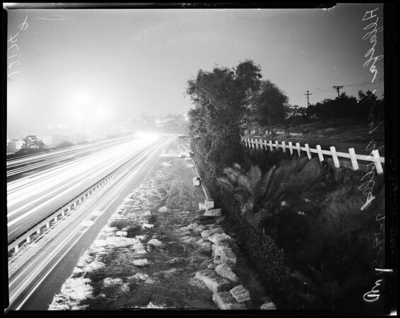 Hay spilled on San Bernardino freeway, 1957
