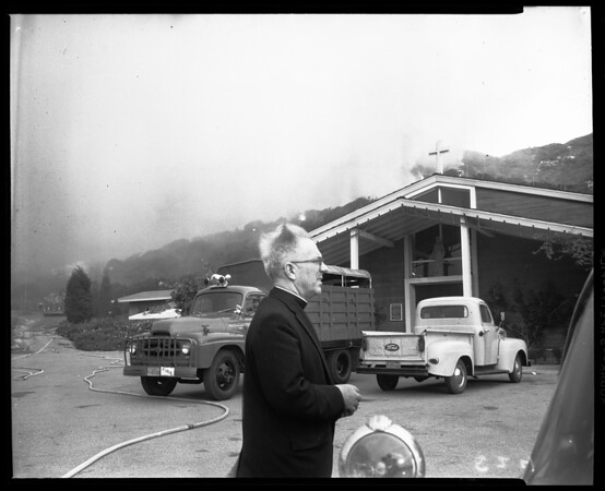 Malibu fire: General view of fire and fire fighters, 1958