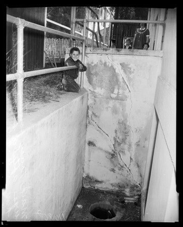 Boy pushed into 10-foot deep basement in Van Nuys, 1954