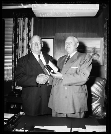 Veteran pressman retires and receives a watch, 1956