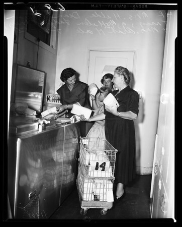 Spastic Children's Foundation receives food from Women's Auxiliary of Los Angeles A.F.L. Central Labor Council, 1956