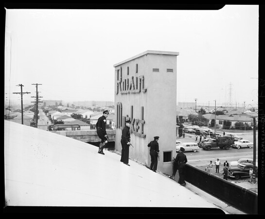 Market holdup and shooting (120th and Avalon), 1955
