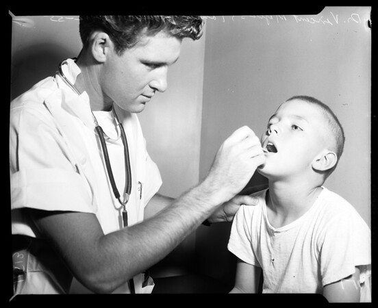 Physical exams for summer campers at California Babies' and Children's Hospital, 1955