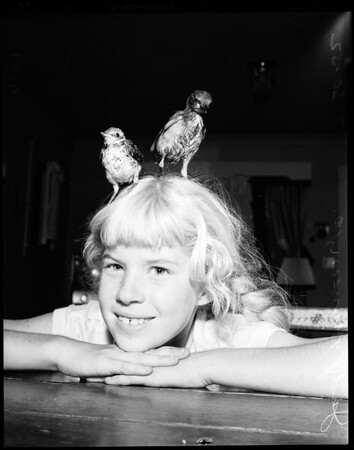 Girl raising birds, 1952