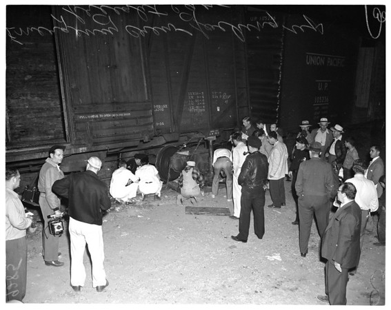 Man trapped under Pacific Electric freight car wheels, Gardena, 1951