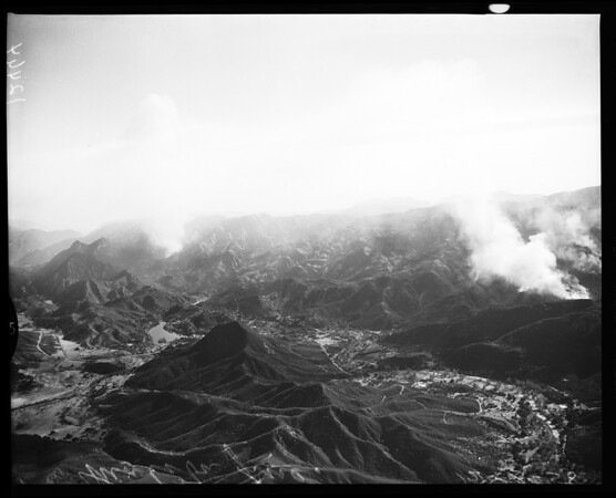 Aerial views of Malibu fire (Lind Flight Service), 1958