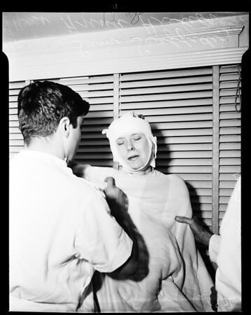 Woman slugged by female robber, 1952
