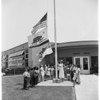 Safety flag raised in Puente, 1952