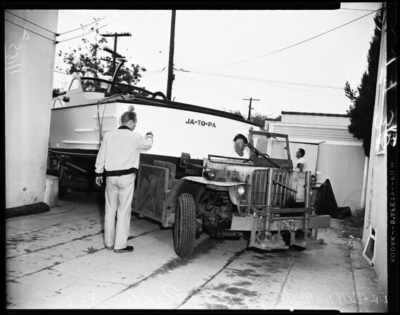 Boat moving (4516 West 11th Place), 1954