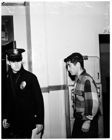 Accused by neighbors of neglecting his 2 months old baby, 1954.