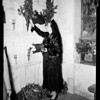 Woman in black at Valentino's tomb, 1952