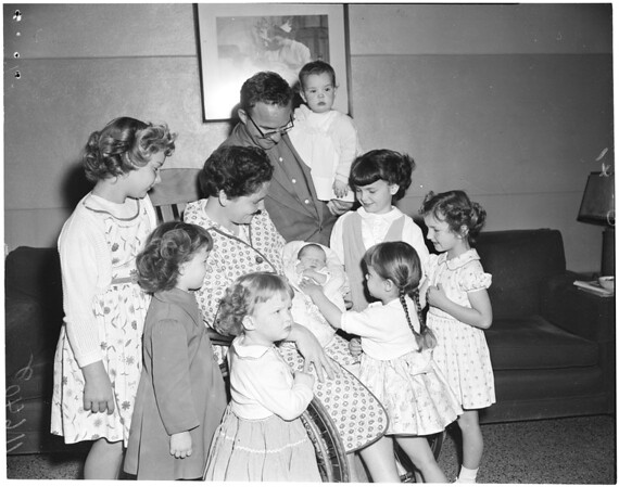 First boy in family of 10 girls,  1955