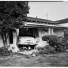 Car through house...West Adams Boulevard, 1951