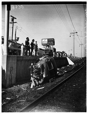 Car over bank, 1951