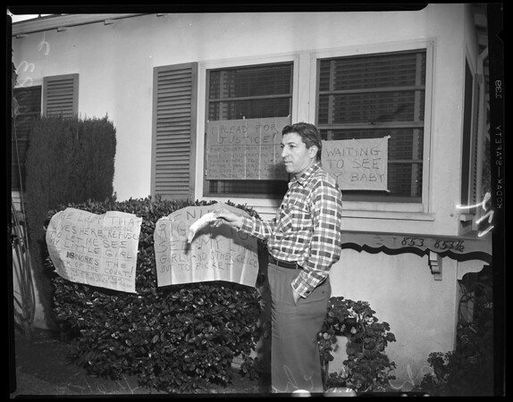 Ex-wife home picketed, 1953