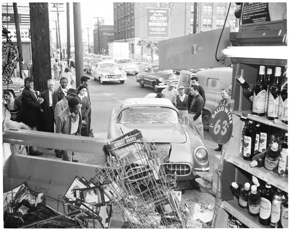 Car into store at Venice Boulevard and Grand Avenue, 1956