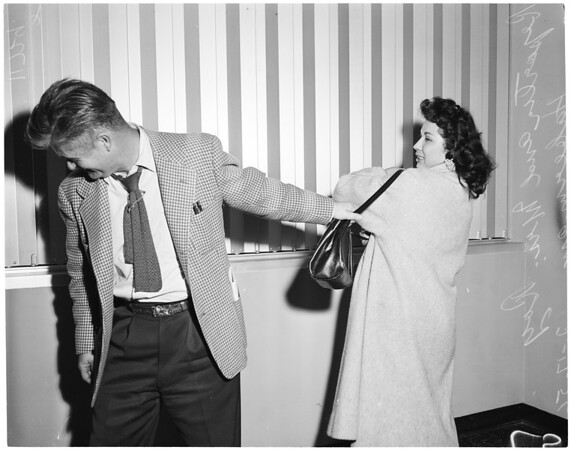 Man robs policeman's wife, 1956