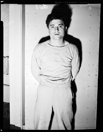 Robbery suspect at university police station, 1954