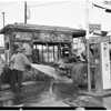 Service station fire at 11th and Wall Streets, 1957