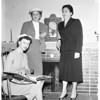 White Auxiliary Children Home Society plan tea, 1957