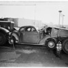 Auto sandwiched between two trucks, 1951