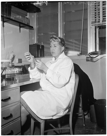 Elizabeth Falk (with test tubes at University of California, Los Angeles), 1960