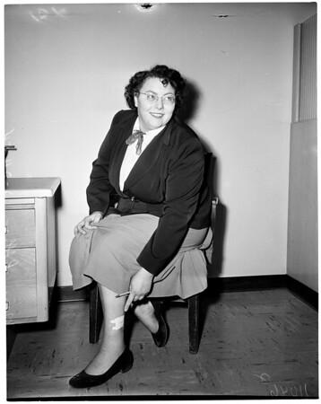 Woman shot in leg, 1954