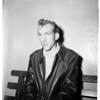Auto crashes cop, 1952